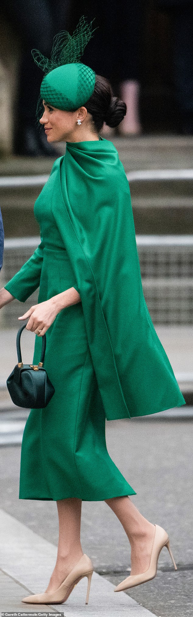GOING GREEN AT A PRICE: For her final outing as a senior member of the Royal Family at March's Commonwealth Day service, Meghan put on an elegant — and expensive — eco display. With her bespoke Emilia Wickstead dress, Meghan carried a £1,695 Demi bag by New York-based designer Gabriela Hearst. Hearst is a purveyor of 'slow fashion'; 99 per cent of her textiles are sustainable, with a focus on zero waste, upcycling and eco-conscious processes. Think cardboard hangers, compostable plastic and humanely farmed leather.