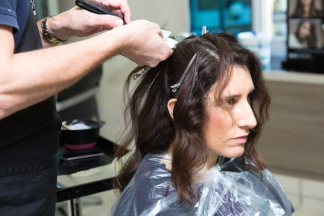 The extensions they used to create the bounce are bonded to the natural locks and put minimal pressure on the hair to reduce damage and sit perfectly flat against the head. Pictured, a lighter highlight is added to Claire's dark hair