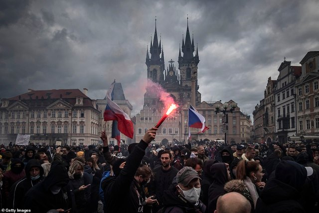 Demonstrators gather to protest against the COVID-19 restrictive measures at Old Town Square. The Czech Republic is under partial lockdown closing schools, bars and clubs until November 3. With 1,106 deaths from Covid-19, the Czech Republic has reported 55,538 new cases in a fortnight