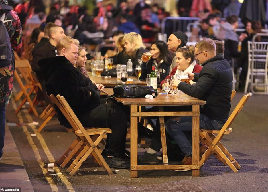 Pub-goers swapped a night in at home to sit outside bars in central London as new restrictions mean multiple households cannot meet inside pubs