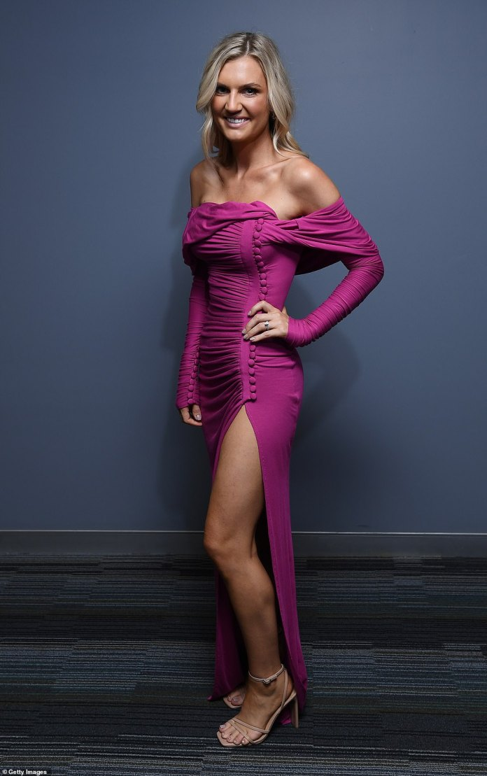 Savahna Lyons, partner of Jarryd Lyons, midfielder for the Brisbane Lions, missed the mark in an off the shoulder fuchsia dress with ruffles on the front and arms that wrapped her petite figure in swaths of fabric