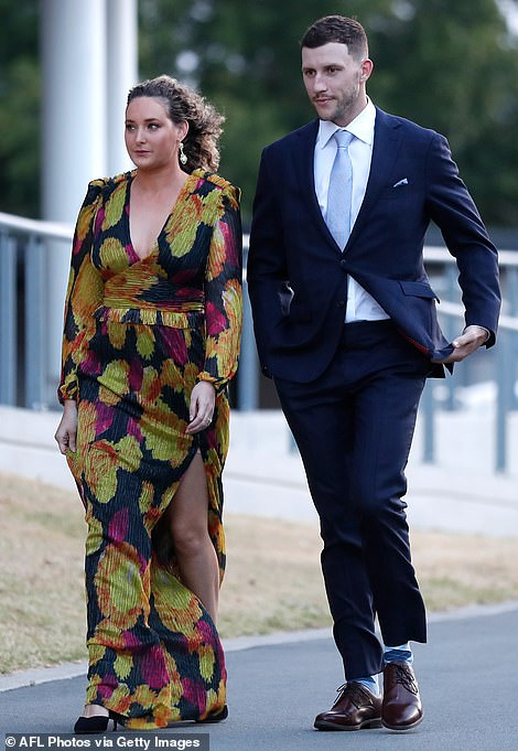 Geelong midfielder Sam Menegola's date fell flat in a dark blue long sleeve gown with a mustard print that felt a bit bland and wintry, a little over a month before summer
