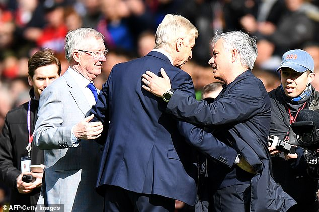 Wenger said on Friday Sir Alex Ferguson (left) was his main rival, not Mourinho (right)