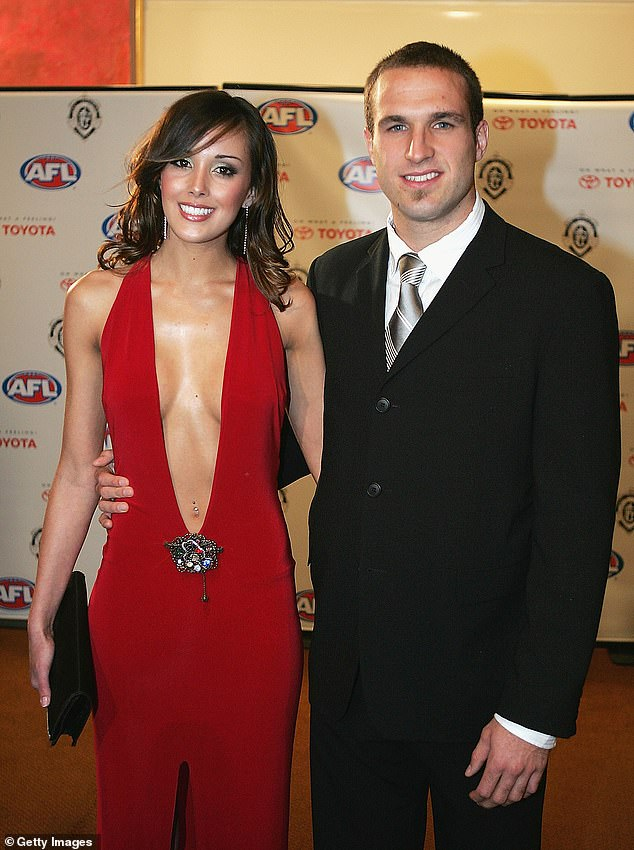 Head-turning: Rebecca made history 16 years ago on the red carpet at the star-studded Brownlow Medal by slipping her slender frame into an iconic custom-made red gown with an extreme plunging neckline. Pictured with Chris Judd