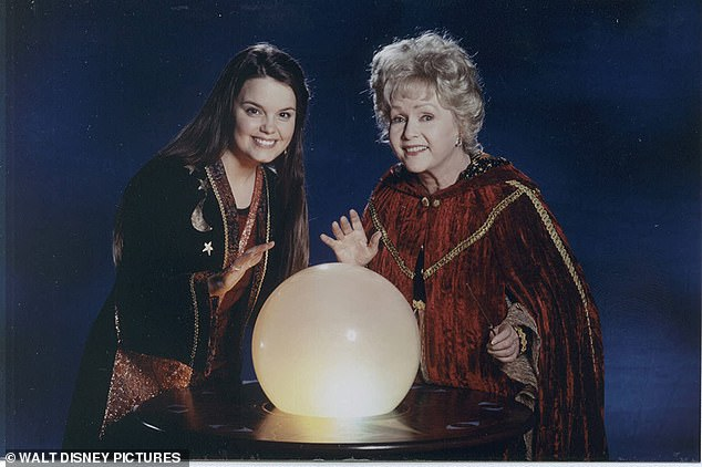 Disney franchise:The Halloweentown film franchise also featured the late Debbie Reynolds who starred as Marnie's witch grandmother, Aggie, and they are shown in a 1998 still