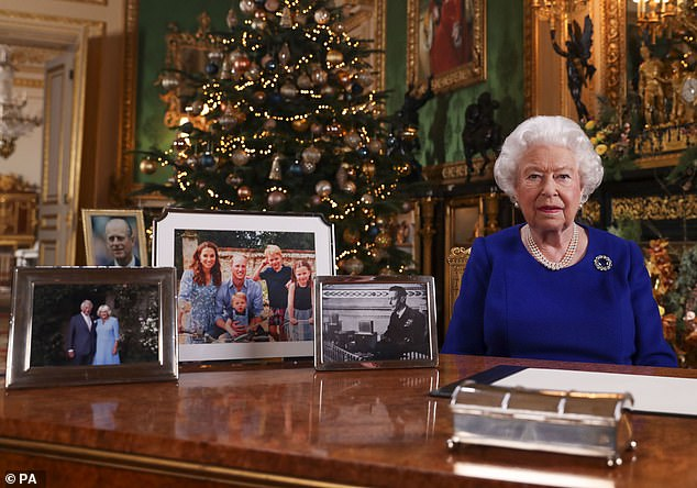 Signs: Royal aides conspired to 'edge' out Harry and Meghan, Lacey claims, through small but clear steps, like removing their picture from the Queen's desk for her 2019 Christmas speech