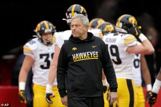 Eight black former Iowa football players demand  million and the firing of head coach Kirk Ferentz 'after enduring racist discrimination' – but the school refuses to comply