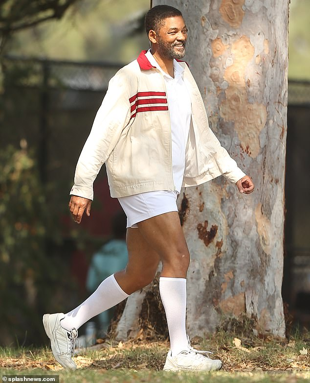 On the way: Smith, 52, was smiling in a red and white tennis outfit and graying stubble, as he made his way to the courts on the film's outdoor set