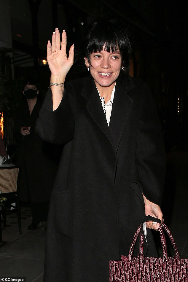 Beaming: The singer, 35, appeared in a good mood as she smiled ear to ear as she left the famous restaurant