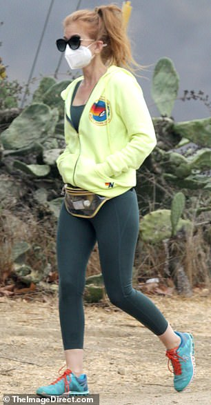 Envy Green: She layered it up with a jade green top and a pair of matching stockings