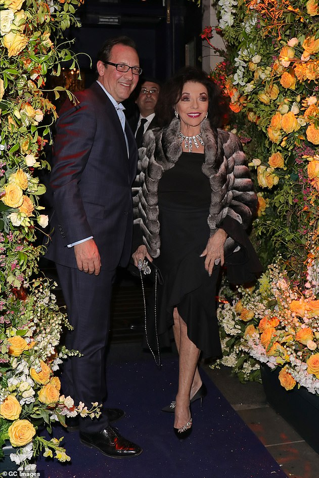 Her love: Joan recently said she has become 'closer than ever' to her husband Percy after the coronavirus lockdown (pictured at Tramp in 2019)