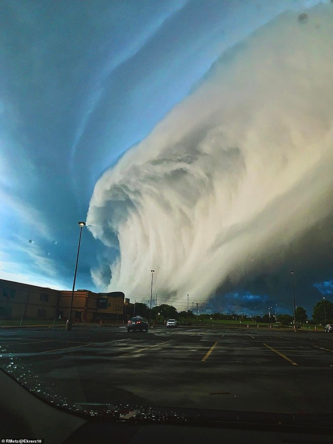 Coming in second in the Young Weather Photographer category was Emma Rose Karsten, with 'Surf's Up,' depicting a 'huge awesome cloud' in the parking lot of her Wildwood, Missouri, high school
