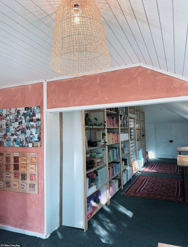 DEN AFTER: A bookcase has helped add dimension to this L-shaped area in the house