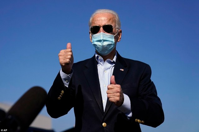 Off to debate: Joe Biden flew from New Castle in Delaware to the debate just after Donald Trump, with a thumbs up as he boarded his chartered jet