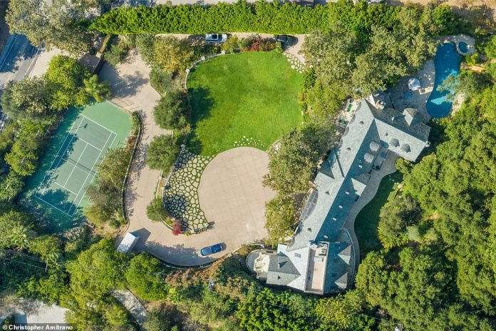 Charming: The mansion is located on two acres of land in Benedict Canyon