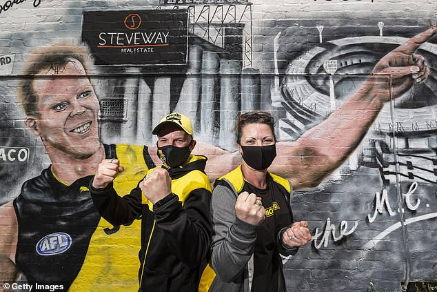 A mural (pictured) featuring Richmond legend Jack Riewoldt ahead of Saturday's AFL grand final versus Geelong