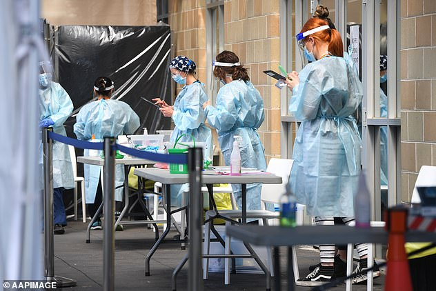 Healthcare workers (pictured in Melbourne on Thursday) remain busy atCOVID-19 testing sites across the state
