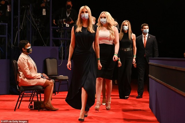 Donald Trump's family finally fully masked up for the final presidential debate, after they were ridiculed for forgoing the precaution at the first candidate face-off. Pictured: Ivanka, Tiffany and Lara Trump enter the debate arena Thursday night