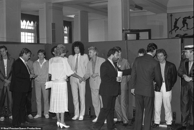 HRH Princess Diana greets the band at Live Aid, UK 1985. Preston was shooting Live Aid for Life Magazine and recalls pictures of all the bands performing. 'It may be a big benefit concert, but photographically, you're essentially shooting a TV show.' 'During a break, he ran into Queen's manager who placed him behind Brian May's amp on stage. 'Suddenly it no longer seemed like a big TV show. It felt like I was home. My band, my crew, home sweet home'