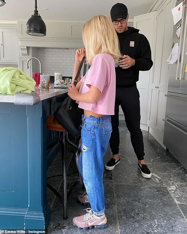 Pride and joy: Emma shared this picture of her very cool son Ace wearing his pink T-shirt and sporting long hair on social media