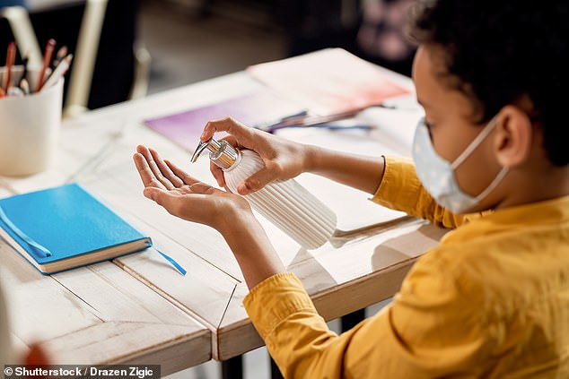 Children who test positive for COVID-19 but show none of the outward signs have lower viral levels than infected, symptomatic kids, a study has found (stock image)