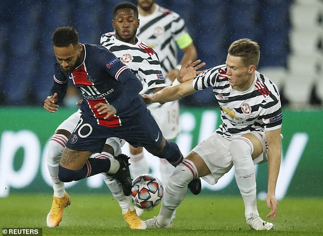 Fred (left) and Scott McTominay work together to dispossess Neymar against PSG this week