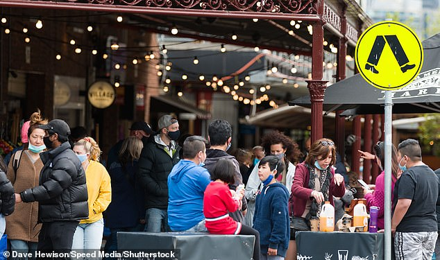 Pictured: South Melbourne Market on Sunday. Locals ignore the Prime Minister's rules and flock to South Melbourne Market, many without masks or social distancing