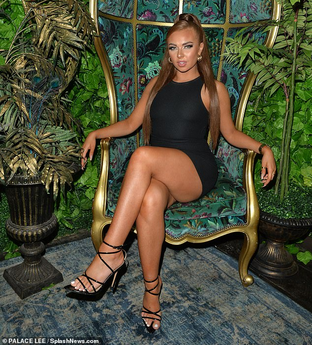 Pose!  Demi grabbed attention in her LBD as she worked the cameras while posing in an ornate chair