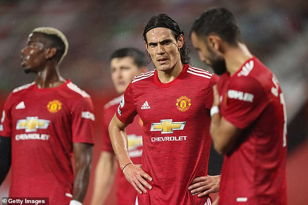 Shaw praised Manchester United's squad depth which includes Edinson Cavani (middle)