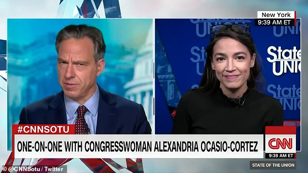 Progressive Representative Alexandria Ocasio-Cortez said she is not 'bothered' by Joe Biden's inconsistent messaging on fracking as she says it's a good 'first step' to transition away from oil