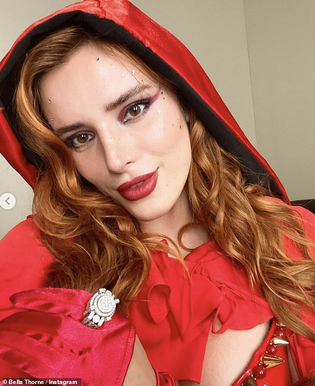 Up close and personal: The babysitter star wore a pair of red satin gloves, and she completed her X-rated look with a smear of bright red lipstick