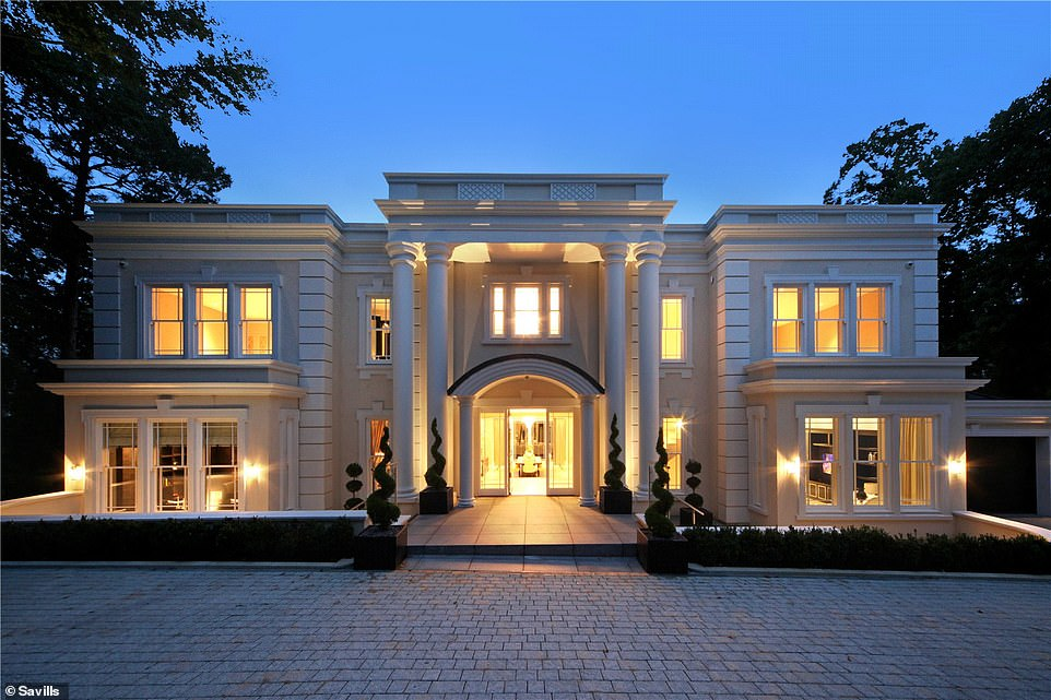 Making a grand entrance: The front of the house has pillars extending up two floors, with an arch over the doorway