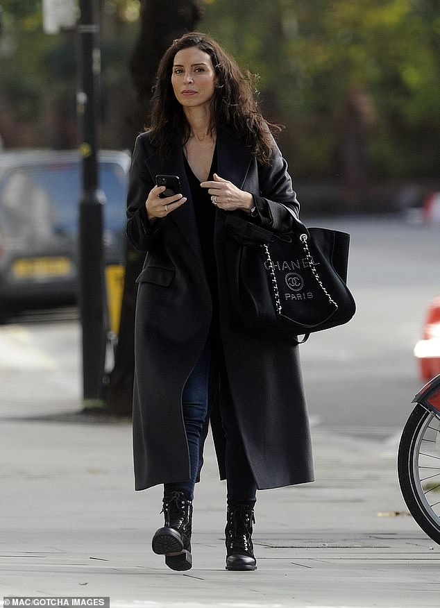 Radiant: Christine Lampard made sure to kiss her wavy tresses as she embarked on a relaxed stroll in London on Monday morning