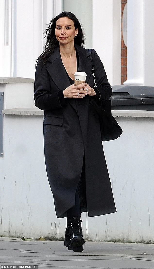 Discreet: The Loose Women panelist, 41, cut a distinctively chic figure as she wrapped herself in the cold climates of the English capital with a long woolen coat and a cup of coffee