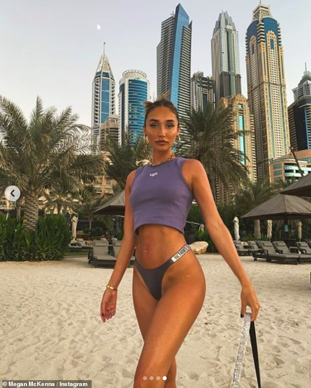 Megan McKenna sends temperatures soaring as she poses in a TINY crop top and thong bikini