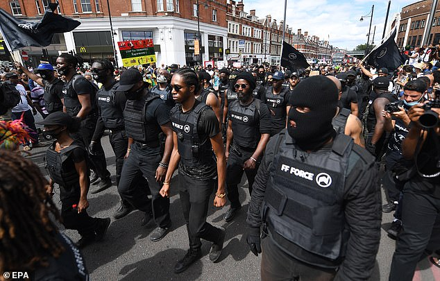 People gather for a Black Lives Matter protest in Brixton