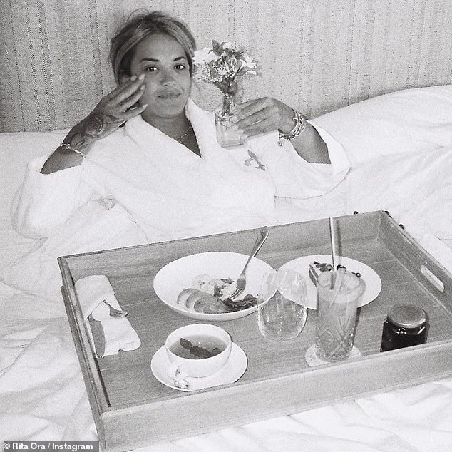 Bliss: The star wrapped up in a fluffy dressing gown and had breakfast in bed in another moment