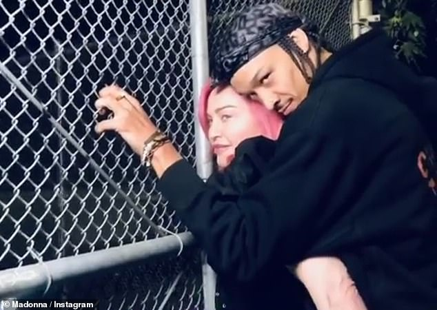 With her boy toy: In a new project, Material Girl shared a cool new video on her feed, posing all in black and accompanied by her boyfriend Ahlamalik Williams