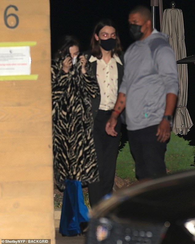 On her way home: Selena Gomez, 28, tried to stay under the radar as she left Nobu Malibu on Monday evening after having dinner with friends