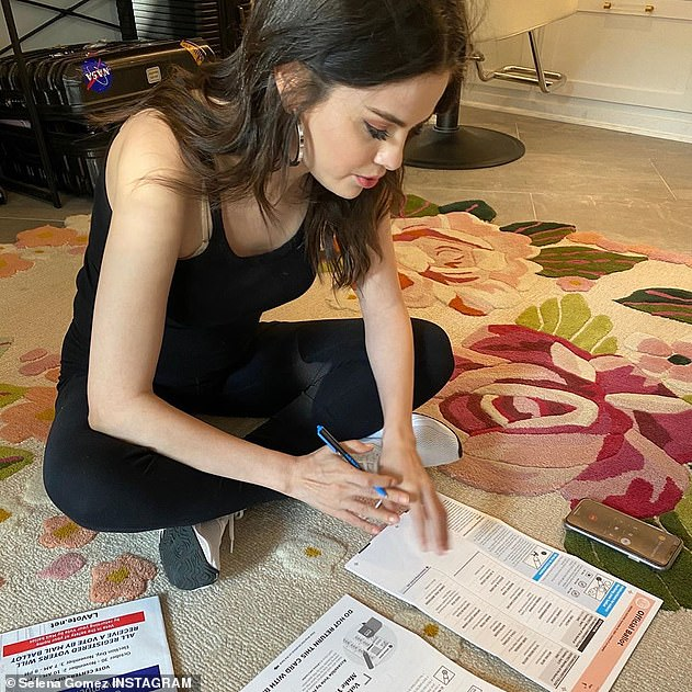 Do it right: A third snapshot showed her sitting on the floor and starting to tag her favorite candidates, and she captioned the message, `` I just finished filling out my ballot!  ''