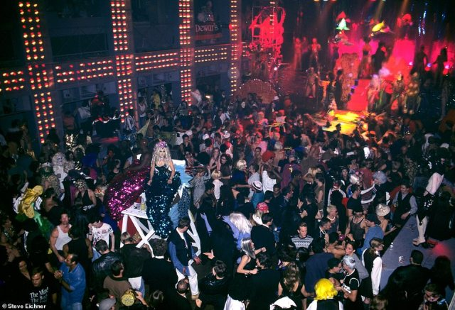 Dance floor: An overview of the massive dance floor at Palladium during an insanely creative fashion party hosted by nightlife diva Suzanne Bartsch. Drag queens dance on platforms while partygoers enjoy libations while the music pumps. 'That was one hell of a party. I hope we can do that again one day,' the photographer recalls