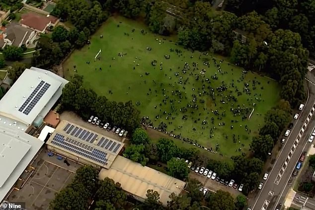 It comes after the biology exam was suspended Wednesday morning after numerous New South Wales schools received a threatening email. Pictured: Students on an oval of an evacuated Castle Hill school on Tuesday