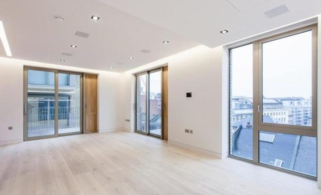 4) This £1.35million two-bedroom fourth floor apartment featuring 1058 sq ft of living space is situated next to Tower Bridge and the River Thames in London but has failed to sell despite being listed on the market since March 7, 2014