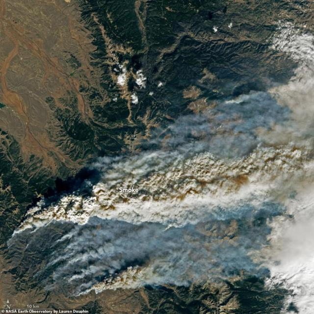 The Operational Land Image (OLI) on the Landsat 8 satellite snapped an image from 438 miles above the blaze that is deemed the state's second largest fire on record – 20 percent is currently contained