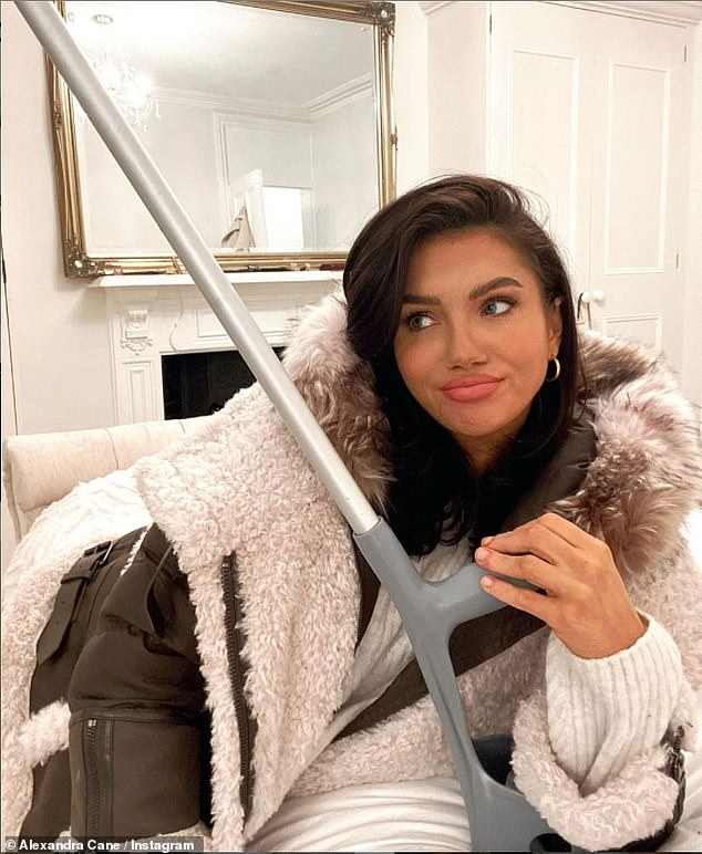 Ouch: The beauty took to Instagram on Wednesday and uploaded snaps of herself with her crutch which she joked was her 'third leg'