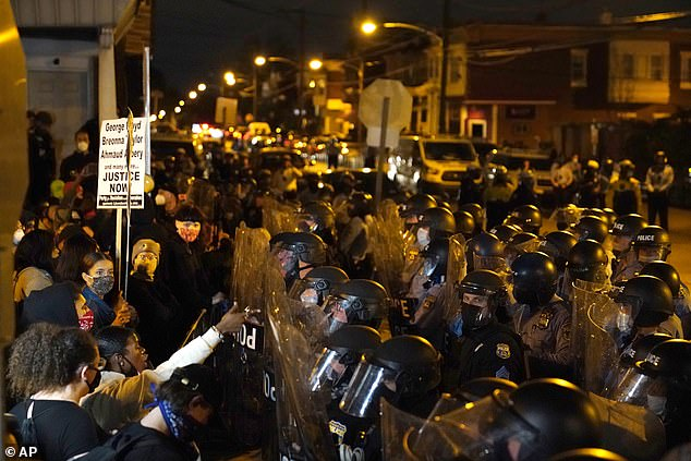Protesters confront police during a march Tuesday in Philadelphia. Hundreds of demonstrators marched in West Philadelphia over the death of Walter Wallace