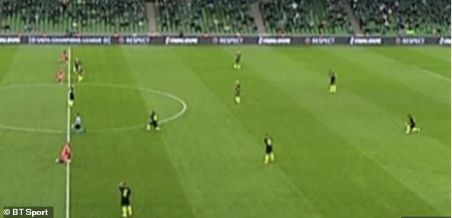 BT Sport coverage briefly showed the scene when seven Krasnodar players failed to get on their knees