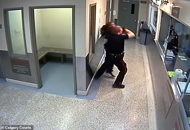 The policeman then forcibly throws her onto the floor face in one swift motion, with her face visibly bouncing off the floor