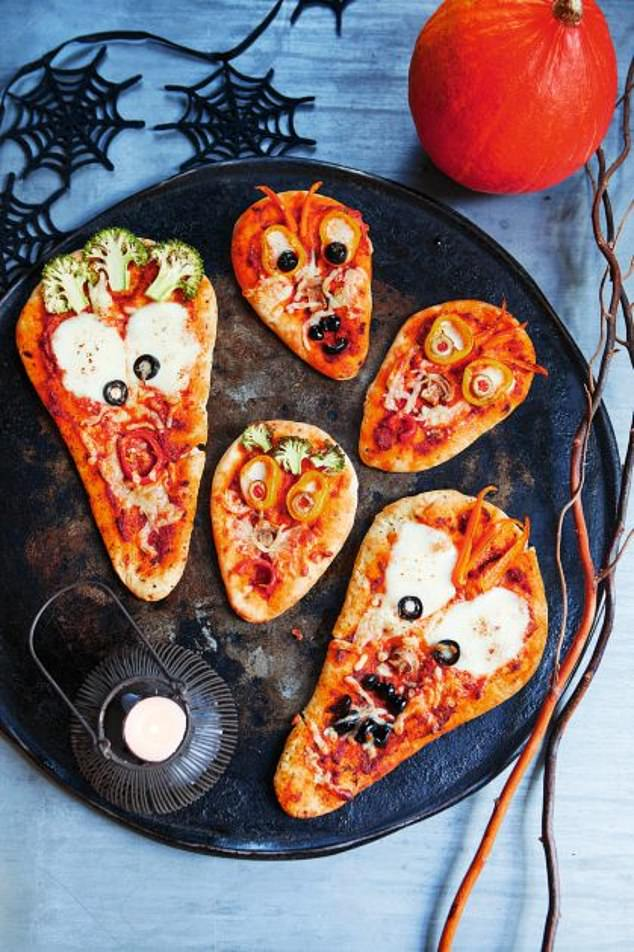 Ghoulish naan pizza are made by creating eyes out of mozzarella slices and placing olives and peppers to give them pupils