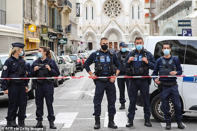 Police block a cordon near the Notre-Dame de l'Assomption basilica in Nice today after a knife killed three people at the church